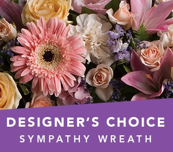 Designer's Choice Sympathy Wreath in SEA LAKE , FARMYARD FLOWERS