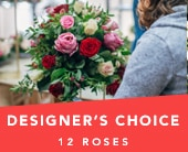 Designer's Choice Dozen Roses in grange , the blu tulip