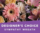 Designer's Choice Sympathy Wreath in blaxland east , red lily floral design